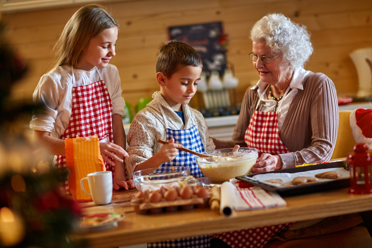 Girl and boy cooking with grandmother